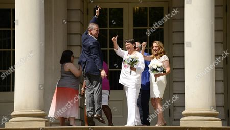 Tom Kirdahy (l) who is Married to Playwright Terrence Mcnally Jumps For Joy While Being Cheered by Katrina Council (r) and Sara Joseph (2-r) After Having His Vows to Mcnally Reaffirmed in a Ceremony Outside of New York City Hall in New York New York Usa 26 June 2015 the Event During Which Two Couples Were Officially Married Along with the Reaffirming of Vows Celebrated Today's Ruling by the United States Supreme Court Which Legalized Gay Marriages Nationwide United States New York