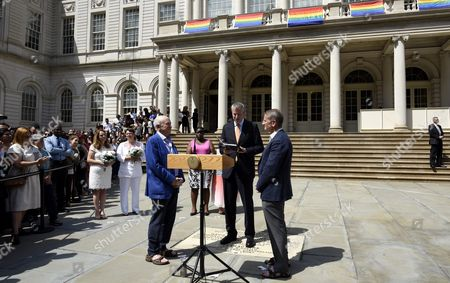 New York City Bill De Blasio (c) Officiates a Reaffirming of Vows Between Tom Kirdahy (r) and Playwright Terrence Mcnally (3-r) During a Ceremony Outside of New York City Hall in New York New York Usa 26 June 2015 the Event During Which Two Couples Were Officially Married Along with the Reaffirming of Vows Celebrated Today's Ruling by the United States Supreme Court Which Legalized Gay Marriages Nationwide United States New York