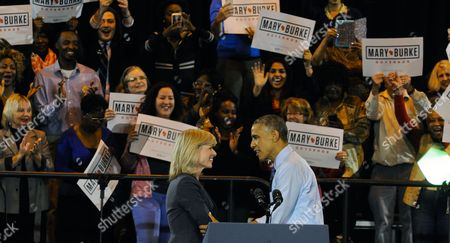 Us President Barack Obama (r) Greets Wisconsin Democratic Gubernatorial Candidate Mary Burke (l) During a Campaign Event For at North Division High School in Milwaukee Wisconsin Usa 28 October 2014 Elections Across the Us For Numerous Races Will Be Held 04 November 2014 United States Milwaukee