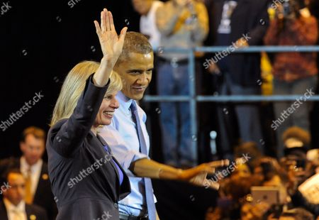 Us President Barack Obama Waves with Wisconsin Democratic Gubernatorial Candidate Mary Burke During a Campaign Event For at North Division High School in Milwaukee Wisconsin Usa 28 October 2014 Elections Across the Us For Numerous Races Will Be Held on 04 November 2014 United States Milwaukee