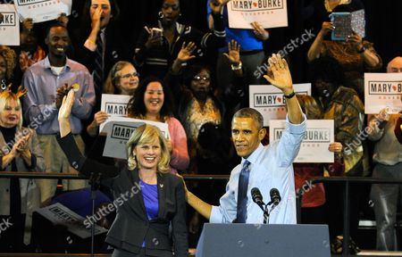 Us President Barack Obama (r) Waves with Wisconsin Democratic Gubernatorial Candidate Mary Burke (l) During a Campaign Event at North Division High School in Milwaukee Wisconsin Usa 28 October 2014 Elections Across the Us For Numerous Races Will Be Held on 04 November 2014 United States Milwaukee