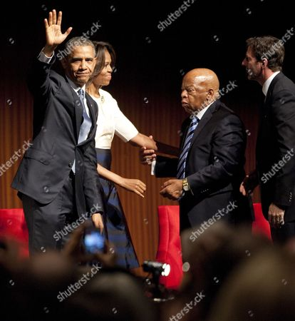 Us President Barack Obama (l) Waves to the Audience While First Lady Michelle Obama (2-l) Greets Congressman John Lewis (3-l) and Mark Updegrove (r) Executive Director of the Lbj Presidential Library After President Obama Spoke in the Lbj Presidential Library at the Civil Rights Summit on the Campus of the University of Texas Usa 10 April 2014 United States Austin