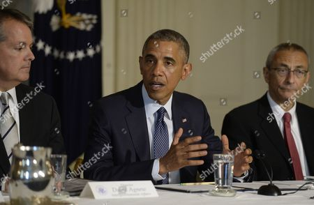 Us President Barack Obama (c) Delivers Remarks Beside Director of Intergovernmental Affairs David Agnew (l) and Former White House Chief of Staff During the Clinton Administration John Podesta (r) During a Meeting of 'State Local and Tribal Leaders Climate Task Force on Preparedness and Resilience' in the State Dining Room of the White House in Washington Dc Usa 16 July 2014 Obama Engaged in a Discussion on Preparing Infrastructure For the Impacts of Climate Change United States Washington