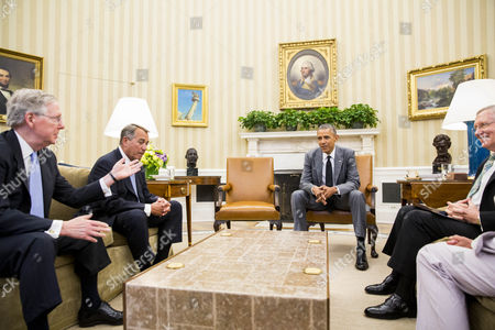 From Left to Right Senate Minority Leader Mitch Mcconnell Speaker of the House John Boehner President Barack Obama and Senate Majority Leader Harry Reid Meet in the Oval Office of the White House in Washington Dc Usa 18 June 2014 According to Press Secretary Jay Carney the President and Congressional Leadership Were Meeting to Discuss Options For the Conflict in Iraq United States Washington