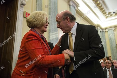 Gm Ignition Compensation Fund Administrator Kenneth Feinberg (r) Greets Democratic Senator From Missouri Claire Mccaskill (l) Before He Testified Before a Senate Commerce Science and Transportation Committee Hearing Called 'Examining Accountability and Corporate Culture in Wake of the Gm Recalls' in the Russell Senate Office Building in Washington Dc Usa 17 July 2014 Lawmakers Want to Know why Top Executives at the American Car Company Were Unaware of the Ignition Switch Problem For More Than a Decade United States Washington