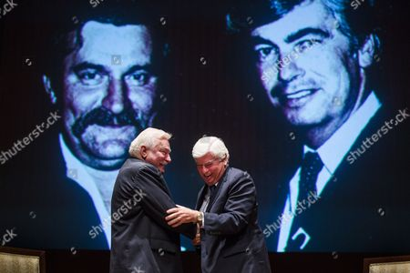 Former President of the Republic of Poland and Nobel Prize Laureate Lech Wasa (l) and Former Democratic Senator From Connecticut and Current President of the Motion Picture Association of America Chris Dodd (r) Shake Hands After Speaking Before a Private Screening of Andrzej Wajdas Film 'Walesa: Man of Hope' at the Us Capitol in Washington Dc Usa 04 December 2013 Behind Walesa and Dodd is a Photograph of the Two of Them From a Meeting in 1983 Also in Attendance at the Screening Were Poland's Ambassador to the Us Ryszard Schnepf the Film's Lead Actor Robert Wieckiewicz and Democratic Senator From Maryland Barabara Mikuslki United States Washington