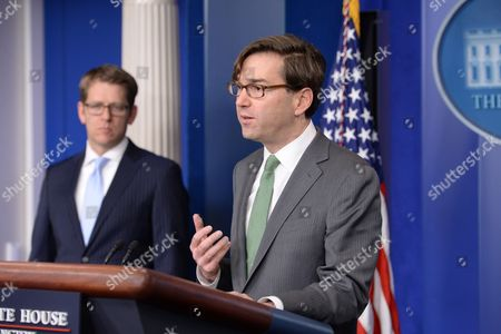 Chairman of the Council of Economic Advisers Jason Furman (r) Delivers Remarks on the Economy in 2013 in Front of White House Press Secretary Jay Carney (l) During a News Conference at the White House in Washington Dc Usa 19 December 2013 United States Washington