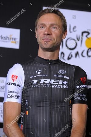 Stock Picture of Trek Factory Racing Procycling Team Rider Jens Voigt of Germany Poses During the Opening Ceremony of the 101st Edition of the Tour De France 2014 Cycling Race in Leeds Great Britain 03 July 2014 the 101st Edition of the Tour De France 2014 Cycling Race Will Start in Leeds on 05 July 2014 with 42 Years Jens Voigt is the Oldest Competitor in the Tour It Will Be the 17th Tour Start For Voigt a Record Only Matched by George Hincapie and Stuart Ogrady United Kingdom Leeds