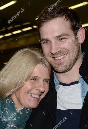 Stock Picture of British Freelance Videographer Kieron Bryan (l) Hugs His Mum Ann (r) on Arrival at St Pancras International Station in London Britain 27 December 2013 the Five Britons Greenpeace Members Anthony Perrett Alexandra Harris and Phil Ball Crew Member Iain Rogers and Freelance Videographer Kieron Bryan Returned to the Uk After Being Held in a Russian Jail For Over Two Months They Were Among 30 Members of the Arctic Sunrise Crew who Were Detained After Climbing a Russian Oil Rig in the Pechora Sea to Protest Arctic Drilling United Kingdom London