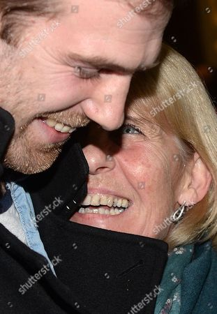 British Freelance Videographer Kieron Bryan (l) Hugs His Mum Ann (r) on Arrival at St Pancras International Station in London Britain 27 December 2013 the Five Britons Greenpeace Members Anthony Perrett Alexandra Harris and Phil Ball Crew Member Iain Rogers and Freelance Videographer Kieron Bryan Returned to the Uk After Being Held in a Russian Jail For Over Two Months United Kingdom London