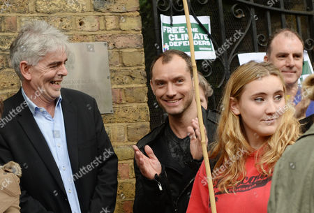 British Actor Jude Law (c) with Greenpeace Uk's Executive Director John Sauven (l) As They Attend a Greenpeace Demonstration Outside the Russian Embassy in Kensington Palace Gardens Central London England 05 October 2013 Greenpeace State That Tens of Thousands of People Have Taken Part in an Emergency Global Day of Solidarity with the 'Arctic 30' in Well Over 80 Cities in 50 Countries Throughout the World 28 Greenpeace International Activists and Two Journalists Were This Week Charged with Piracy by a Russian Court Following a Peaceful Protest Against Arctic Oil Drilling at a Gazprom Oil Platform in the Pechora Sea United Kingdom London