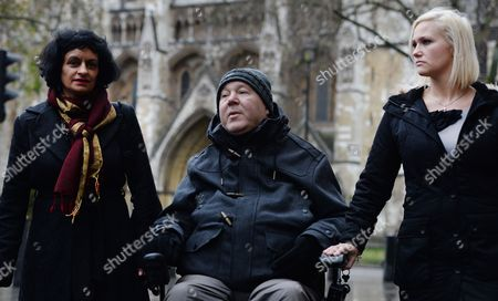 Paul Lamb with His Lawyer Saimo Chahal (l) and His Carer Micaela Turner (r) Outside the Supreme Court in London Britain 16 December 2013 Campaigners For the Right to Die Are to Have Their Arguments Heard by the Supreme Court in the Latest Round of Their Legal Battle the Families of the Late Tony Nicklinson who Had Locked-in Syndrome and Paul Lamb of Leeds who was Paralysed in a Road Crash Were Demanding a Change of Current Laws in Order to Be Allowed to Die with the Help of a Doctor Judgement is Likely to Be Issued at a Later Date United Kingdom London