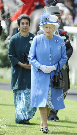 Britain's Queen Elizabeth Ii (r-front) and Princess Sarvath El Hassan of Jordan (l-back) Arrive to the Fourth Day of Royal Ascot in Ascot Britain 21 June 2013 Ascot is Well Known For Its Strict Dress Code of Hats the Horse Race Meeting Runs From 18 to 22 June United Kingdom Ascot
