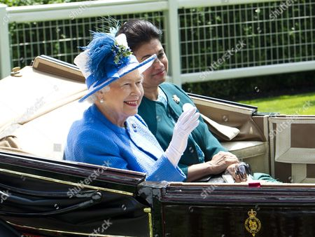 Britain's Queen Elizabeth Ii (l) and Princess Sarvath El Hassan of Jordan (r) Arrive to the Fourth Day of Royal Ascot in Ascot Britain 21 June 2013 Ascot is Well Known For Its Strict Dress Code of Hats the Horse Race Meeting Runs From 18 to 22 June United Kingdom Ascot