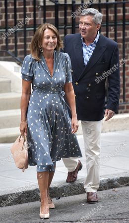 Stock Photo of Carole (l) and Michael Francis (r) Middleton the Parents of the Duchess of Cambridge Depart St Mary's Hospital in London Britain 23 July 2013 After Visiting the Royal Couple and Their Newborn Baby Boy Thirty-one Year Old Catherine Duchess of Cambridge Gave Birth to Her and Prince William's First Child at 4 24pm Bst at the Lindo Wing of St Mary's Hospital on 22 July United Kingdom London