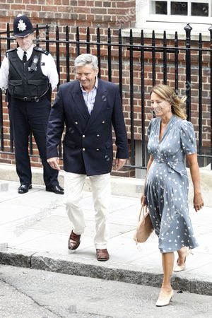 Michael Francis (l) and Carole (r) Middleton the Parents of the Duchess of Cambridge Depart St Mary's Hospital in London Britain 23 July 2013 After Visiting the Royal Couple and Their Newborn Baby Boy Thirty-one Year Old Catherine Duchess of Cambridge Gave Birth to Her and Prince William's First Child at 4 24pm Bst at the Lindo Wing of St Mary's Hospital on 22 July United Kingdom London