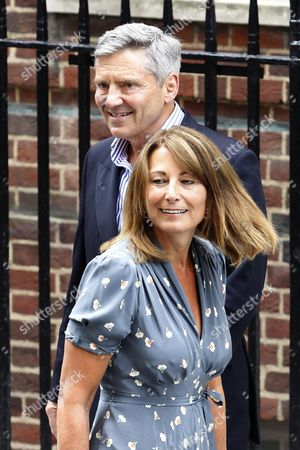 Stock Picture of Carole (front) and Michael Francis Middleton the Parents of the Duchess of Cambridge Depart St Mary's Hospital in London Britain 23 July 2013 After Visiting the Royal Couple and Their Newborn Baby Boy Thirty-one Year Old Catherine Duchess of Cambridge Gave Birth to Her and Prince William's First Child at 4 24pm Bst at the Lindo Wing of St Mary's Hospital on 22 July United Kingdom London
