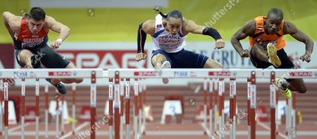 (l-r) Erik Balnuweit of Germany Pascal Martinot Lagarde of France and Gregory Sedoc of the Netherlands Compete in the Men's 60m Hurdles Semi Final During the European Athletics Indoor Championships 2015 at the 02 Arena in Prague Czech Republic 06 March 2015 Czech Republic Prague