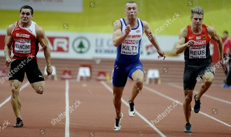 (l-r) Swiss Pascal Mancini Richard Kilty of Britain and Julian Reus of Germany Compete in the Men's 60 Meters Final Race During the European Athletics Indoor Championships 2015 at the 02 Arena in Prague Czech Republic 08 March 2015 Czech Republic Prague
