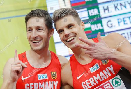 Stock Picture of German Athletes Silver Medalist Christian Blum (l) and Bronze Julian Reus (r) Celebrate After Men's 60m Final During the European Athletics Indoor Championships 2015 at the O2 Arena in Prague Czech Republic 08 March 2015 Czech Republic Prague