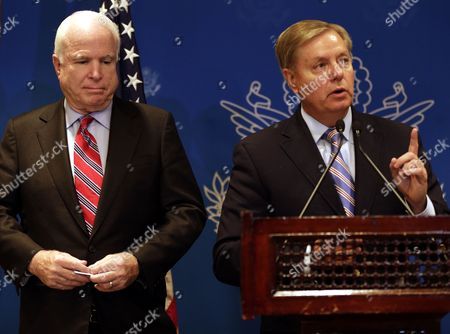 Us Senators John Mccain (l) and Lindsey Graham (r) Address a Joint Press Conference in Cairo Egypt 06 August 2013 the Us Senators Addressed a Press Conference After Meetings Earlier the Same Day with Egyptian Vice Prime Minister and Minister of Defense General Abdel Fattah Al-sisi Vice President Mohamed Elbaradei As Well As a Senior Member of Egypt's Muslim Brotherhood in Jail the Day Before Amid Efforts to End a Political Stalemate in the Country Egypt Cairo