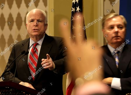Us Senators John Mccain (l) Gestures As He Answers Journalists' Questions During a Joint Press Conference with Senator Lindsey Graham (r) a in Cairo Egypt 06 August 2013 the Us Senators Addressed a Press Conference After Meetings Earlier the Same Day with Egyptian Vice Prime Minister and Minister of Defense General Abdel Fattah Al-sisi Vice President Mohamed Elbaradei As Well As a Senior Member of Egypt's Muslim Brotherhood in Jail the Day Before Amid Efforts to End a Political Stalemate in the Country Egypt Cairo