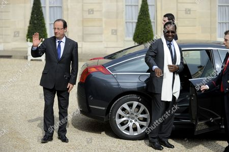 French President Francois Hollande (l) and President of Mali Dioncounda Traore (r) As Dioncounda Leaves Following Their Meeting at the Elysee Palace in Paris France 17 May 2013 France Paris