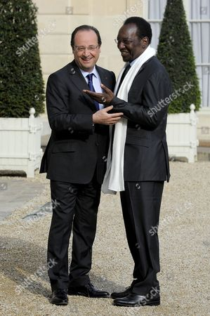 Stock Photo of French President Francois Hollande (l) Greets President of Mali Dioncounda Traore (r) Upon His Arrival at the Elysee Palace in Paris France 17 May 2013 France Paris