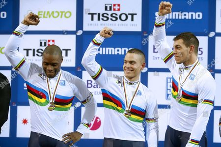 France's (l-r) Gregory Bauge Michael D'almeida and Kevin Sireau Celebrate on the Podium After Winning the Men's Team Sprint of the 2015 Uci Track Cycling World Championships in Saint-quentin-en-yvelines France 18 February 2015 France Saint-quentin-en-yvelines