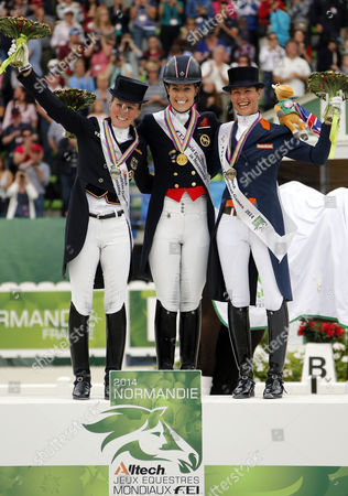 (l-r) German Helen Langehanenberg British Charlotte Dujardin and Dutch Adelinde Cornelissen Celebrate on the Podium After the Freestyle Grand Prix Dressage Competition During the World Equestrian Games 2014 in Caen France 29 August 2014 France Caen