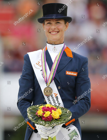 Dutch Rider Adelinde Cornelissen Celebrates Her Bronze Medal on the Podium After the Grand Prix Freestyle Dressage Competition During the World Equestrian Games 2014 in Caen France 29 August 2014 France Caen