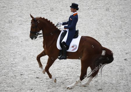 Stock Picture of Dutch Rider Adelinde Cornelissen on Horse Jerich Parzival N O P Competes in the Grand Prix Freestyle Dressage Competition During the World Equestrian Games 2014 in Caen France 29 August 2014 France Caen