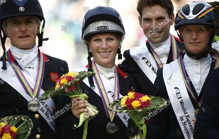 (l-r) Silver Medalists Kristina Cook Zara Phillips and Harry Meade of Britain and Gold Medalist Sandra Auffarth of Germany Celebrate on the Podium For the Team Classification of the Jumping Test As Part of the Eventing Competition at the World Equestrian Games 2014 in Caen France 31 August 2014 France Caen