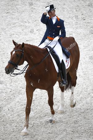 Stock Photo of Dutch Rider Adelinde Cornelissen on Horse Jerich Parzival N O P Waves After Competing in the Grand Prix Freestyle Dressage Competition During the World Equestrian Games 2014 in Caen France 29 August 2014 France Caen
