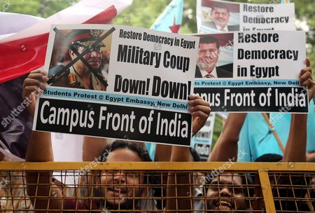 Protesters From the Egypt Solidarity Forum Shout Slogans and Raise Placards During a Protest Outside the Egyptian Embassy in New Delhi India 01 August 2013 the Demonstration was Held to Protest Against Egypt's Defense Minister General Abdel-fattah El-sissi and Interim Vice President Mohamed Elbaradei Which They Blame For what They Call a 'Military Coup in Egypt' to Oust Muslim Brotherhood Politician Mohammed Morsi Egypt's First Democratically Elected President India New Delhi