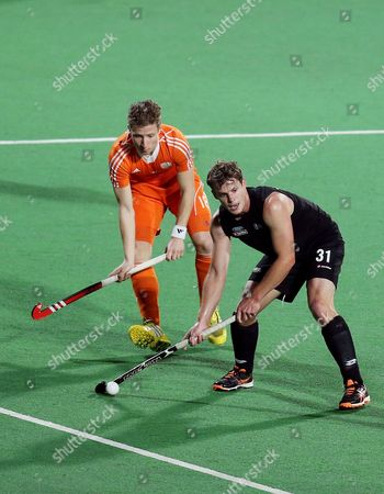 Steve Edwards of New Zealand (r) in Action Against Buissant of Netherlands in the Final Match of the Hockey World League in New Delhi India 18 January 2014 India New Delhi