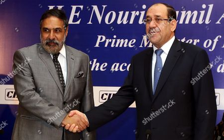 Iraqi Prime Minister Nouri Kamil Al-maliki (r) Shakes Hand with Indian Minister of Commerce & Industry Anand Sharma During a Business Meeting in New Delhi India 23 August 2013 Prime Minister Nouri Kamil Al-maliki is in India on a Four Day State Visit and is Scheduled to Meet India's Top Politicians to Strengthen the Political and Business Ties Between the Two Countries India New Delhi