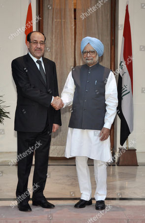 Iraqi Prime Minister Nouri Kamil Al-maliki (l) Shakes Hand with India's Prime Minister Manmohan Singh As They Pose For the Media Prior to Their Meeting in New Delhi India 23 August 2013 Al-maliki is in India on a Four-day State Visit During Which He is Scheduled to Meet India's Top Politicians to Strengthen the Political and Business Ties Between the Two Countries India New Delhi