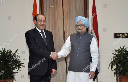 Stock Photo of Iraqi Prime Minister Nouri Kamil Al-maliki (l) Shakes Hand with India's Prime Minister Manmohan Singh As They Pose For the Media Prior to Their Meeting in New Delhi India 23 August 2013 Al-maliki is in India on a Four-day State Visit During Which He is Scheduled to Meet India's Top Politicians to Strengthen the Political and Business Ties Between the Two Countries India New Delhi