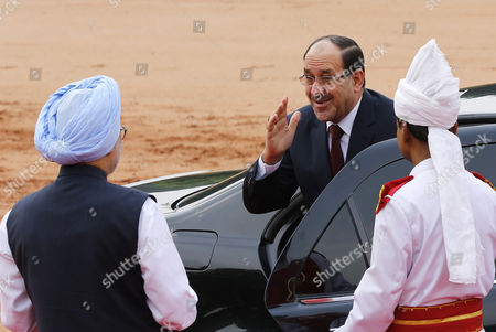 Prime Minister of Iraq Nouri Kamil Al-maliki (r) Greets Indian Prime Minister Manmohan Singh As He Arrives to Attend His Welcoming Ceremony at the Indian President S House in New Delhi India 23 August 2013 Prime Minister Nouri Kamil Al-maliki in India on a State Four Day State Visit and is Scheduled to Meet India's Top Politicians to Strengthen the Political and Business Ties Between the Two Countries India New Delhi