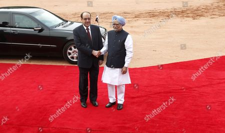 Stock Picture of Indian Prime Minster Manmohan Singh (in Blue Headgear) Shake Hands with Prime Minister of Iraq Nouri Kamil Al-maliki During His Welcoming Ceremony at the Indian President S House in New Delhi India 23 August 2013 Prime Minister Nouri Kamil Al-maliki in India on a State Four Day State Visit and is Scheduled to Meet India's Top Politicians to Strengthen the Political and Business Ties Between the Two Countries India New Delhi