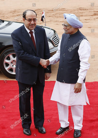 Indian Prime Minster Manmohan Singh (r) with Prime Minister of Iraq Nouri Kamil Al-maliki Shake Hands During a Welcoming Ceremony at the Indian President S House in New Delhi India 23 August 2013 Prime Minister Nouri Kamil Al-maliki in India on a State Four Day State Visit and is Scheduled to Meet India's Top Politicians to Strengthen the Political and Business Ties Between the Two Countries India New Delhi