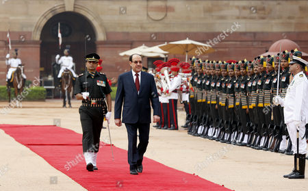 Stock Image of Prime Minister of Iraq Nouri Kamil Al-maliki (c-r) Inspects the Guard of Honor During a Welcoming Ceremony at the Indian President S House in New Delhi India 23 August 2013 Prime Minister Nouri Kamil Al-maliki in India on a State Four Day State Visit and is Scheduled to Meet India's Top Politicians to Strengthen the Political and Business Ties Between the Two Countries India New Delhi