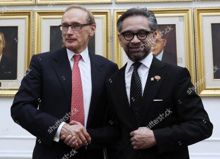Australia's Foreign Affairs Minister Bob Carr (l) is Greeted by His Indonesian Counterpart Marty Natalegawa During a Meeting on the Sidelines of the Special Conference on Irregular Movement of Persons in Jakarta Indonesia 20 August 2013 Senior Officials From Indonesia Australia Cambodia Malaysia Papua New Guinea Philippines New Zealand Thailand and Afganistan Discussed Irregular Migration Issues Including Asylum Seekers and Human Smuggling During a One Day Conference Since 2008 Almost 50 000 Asylum-seekers Have Arrived by Boat in Australia and More Than 1 000 Have Drowned when Their Flimsy Crafts Failed to Make the 360-kilometre Journey From the Coast of Java to Australia's Christmas Island Outpost Indonesia Jakarta