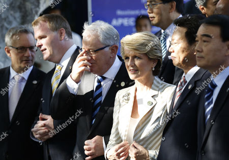 (l-r) Canada's Minister For International Trade Ed Fast Canada's Foreign Minister John Baird Australia's Minister For Trade and Investment Andrew Robb Australia's Foreign Minister Julie Bishop China Vice Minister of Commerce Yu Jianhua China's Vice Minister For Foreign Affairs Li Baodong During the Group Shot of Foreign and Trade Ministers at the Start of the Asia-pacific Economic Cooperation (apec) Ministerial Meeting (amm) Summit in Nusa Dua Bali Indonesia 04 October 2013 Indonesia's Resort Island of Bali is Hosting the Apec Summit Until 08 October 2013 Indonesia Nusa Dua