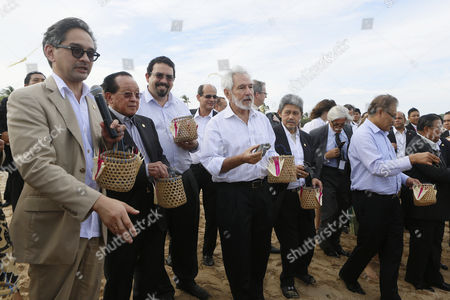 (l-r) Indonesian Foreign Minister Marty Natalegawa Cambodian Foreign Minister Hor Namhong Venezuela Vice Foreign Minister David Velasquez Caraballo Nicaraguan Foreign Minister Samuel Santos Lopez and Brunei Darussalam Foreign Minister Prince Mohamed Bolkiah Hold Sea Turtle Hatchling Shortly Before They Are Released Into the Sea on the Sidelines of the 6th Forum For East Asia-latin America Cooperation (fealac) in Nusa Dua Bali Indonesia 13 June 2013 Indonesian Resort Island of Bali Host the 6th Fealac Meeting on 13 and 14 June 2013 and Attended by Seventeen Foreign Ministers From East Asia and Latin America Countries Indonesia Denpasar