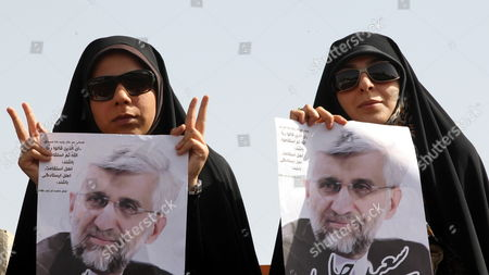 Female Supporters of Iranian Presidential Candidate Saeed Jalili Hold Posters Depicting Jalili During an Election Campaign Rally in Tehran Iran 12 June 2013 Iran Will Hold Presidential Elections on 14 June 2013 Iran (islamic Republic Of) Tehran