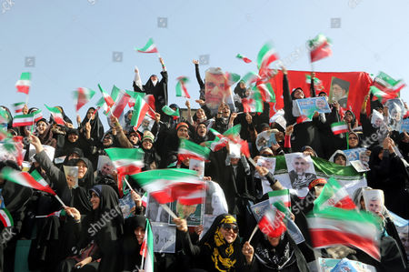 Female Supporters of Iranian Presidential Candidate Saeed Jalili Hold Posters Depicting Jalili and Wave Iranian Flags During an Election Campaign Rally in Tehran Iran 12 June 2013 Iran Will Hold Presidential Elections on 14 June 2013 Iran (islamic Republic Of) Tehran