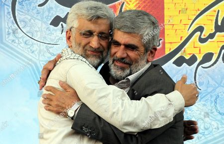 Iranian Presidential Candidate Saeed Jalili (l) Hugs the Father of Iranian Assassinated Nuclear Scientist Mostafa Ahmadi-rowshan During an Election Campaign Rally in Tehran Iran 12 June 2013 Iran Will Hold Presidential Elections on 14 June 2013 Iran (islamic Republic Of) Tehran