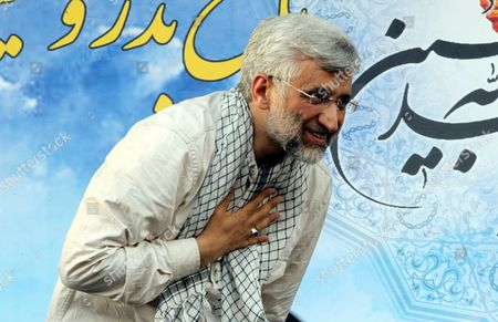 Iranian Presidential Candidate Saeed Jalili Gestures to His Supporters During an Election Campaign Rally in Tehran Iran 12 June 2013 Iran Will Hold Presidential Elections on 14 June 2013 Iran (islamic Republic Of) Tehran